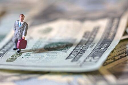 Business man on bills Stock Photo - 3736145