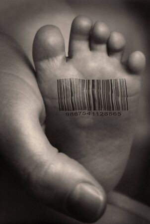 id: Babies foot with barcode Stock Photo
