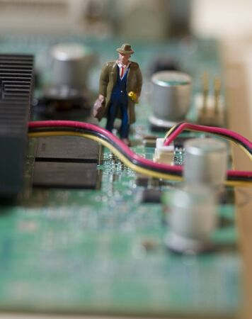 Businessman navigates inside Circuit Board photo
