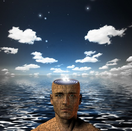 mentality: Puzzle piece in mans open mind Stock Photo