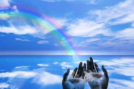 rainbow abstract: Rainbow ends in Hands Stock Photo