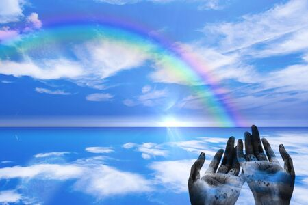 enchantment: Rainbow ends in Hands Stock Photo