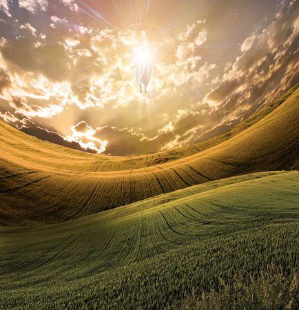 Figure of Light Appears in Sky over Beautiful Landscape 스톡 콘텐츠
