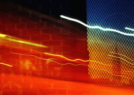Empire State Building seen through a window with light trails photo