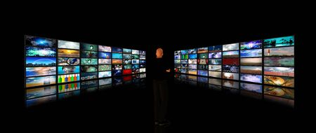 Man viewing video displays Stock Photo - 6851070
