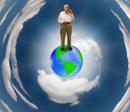 online internet presence: Senior on Earth using Cell phone Stock Photo