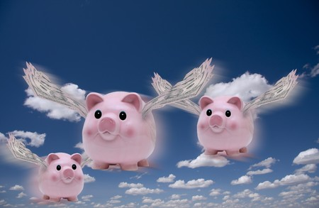 Pigs with money wings in flight Banque d'images