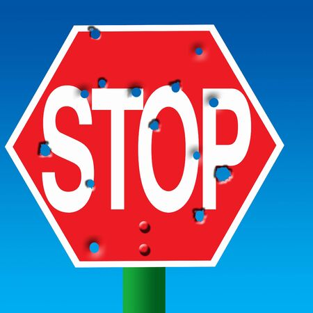 Bullet riddled stop sign photo
