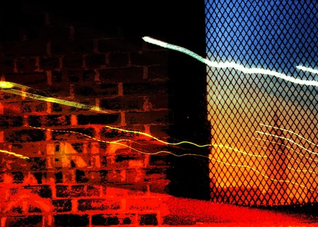 gritty: Empire State Building seen through a window with light trails