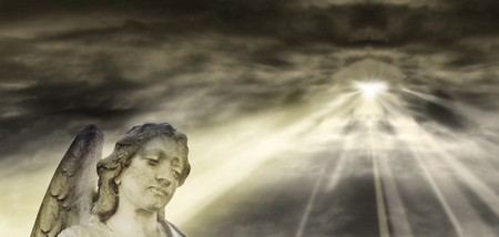 Angel and dramatic sky  Standard-Bild - 7573998