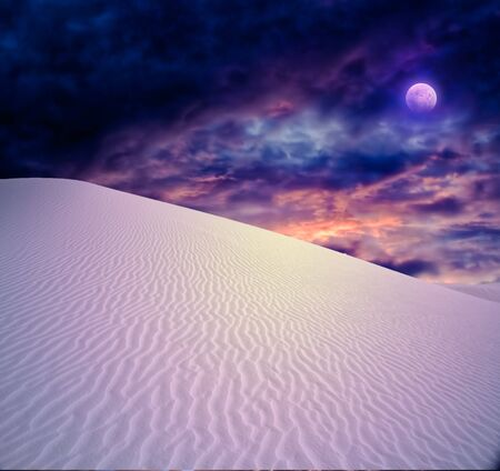 over hill: Full moon at White Sands New Mexico