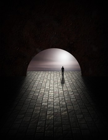 the end: Mystery Man in Tunnel Stock Photo