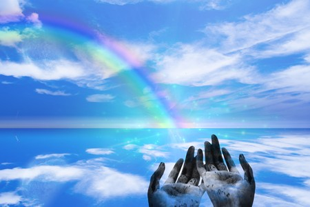 the end: Rainbow ends in Hands Stock Photo