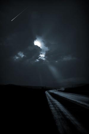 dark: Single car travels on dark road Stock Photo