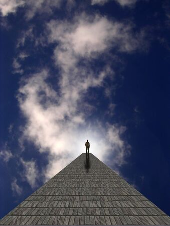 spiritual journey: Man atop stone in clouds