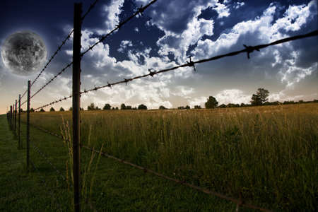 Sky with clouds and Farmers Fence and field Stock Photo - 9222952