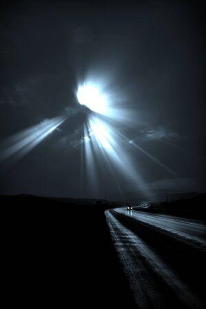 Single car travels on dark road photo