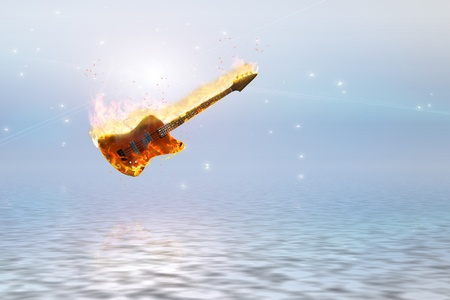 Burning bass guitar over clean pure ocean photo
