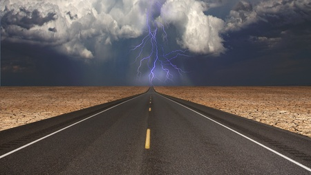 Empty road in desert storm Stock Photo - 12427524