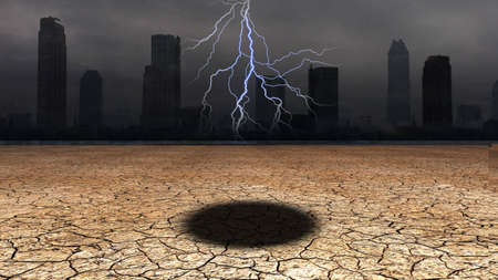 Dark city with hole in desert floor photo