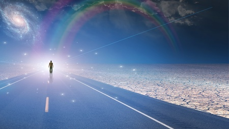 ways to go: Man bathed in light and roadway Stock Photo