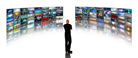 high definition: Man viewing video displays