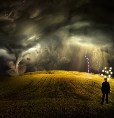 Man has many ideas in stormy field photo