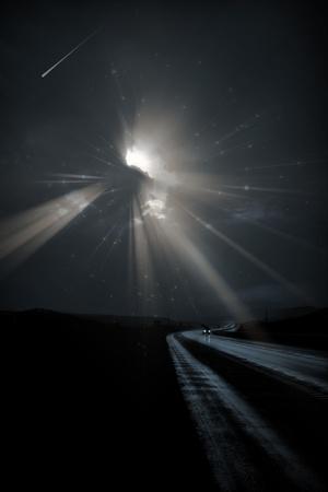 dark: Single car travels on dark road under stars