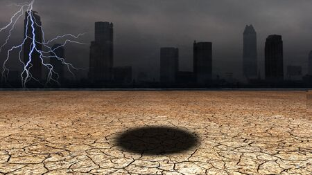 industry moody: Dark city with hole in desert floor