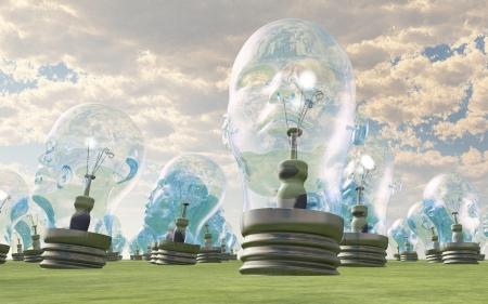Groep van menselijk hoofd gloeilampen in het landschap Stockfoto