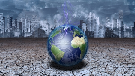 Earth sits in dried cracked mud before metropolis photo