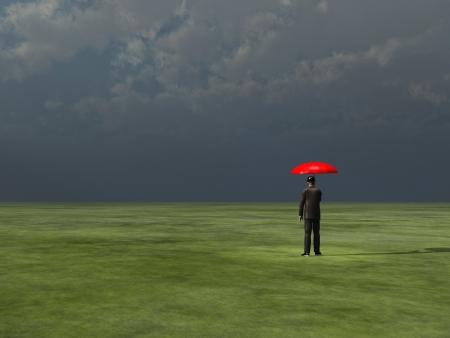 Man with red umbrella under gathering storm Reklamní fotografie