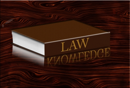 expertise concept: Law book reflects knowledge in desktop
