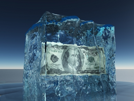 One hundred dollar bill frozen in ice photo