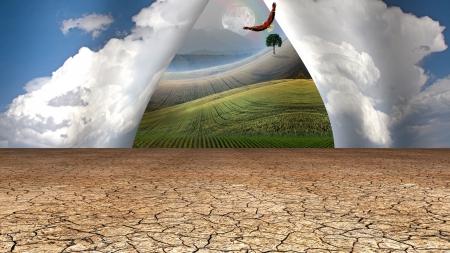 beyond: Desert sky opens to green beyond Stock Photo
