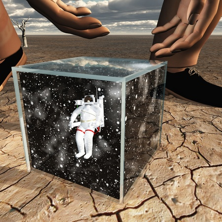 Human about to pick up box containing astronaut and space Banco de Imagens