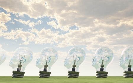 Row of human head lightbulbs in landscape Stock Photo - 15536259