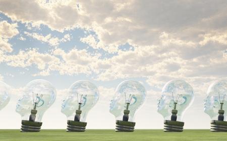 Row of human head lightbulbs in landscape Stock Photo - 15536259