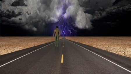 spiritual growth: Man on road confronts storm