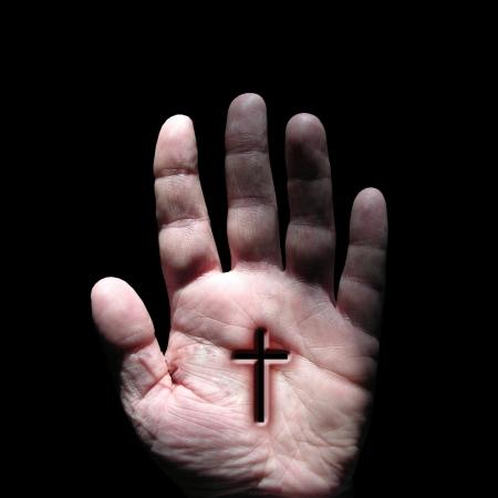 christian worship:  cross symbol at hand