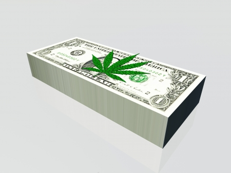 Pile of US currency and marijuana leaf photo