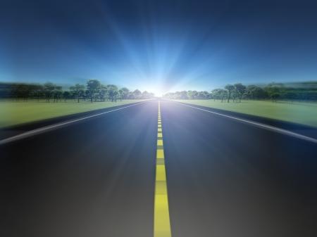 toward: Road in green landscape moving toward light