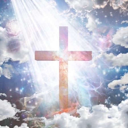 christmas prayer: Cross in light Stock Photo