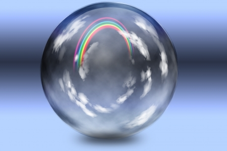 Rainbow and clouds trapped in clear glass sphere