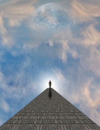 atop: Man atop stone in clouds