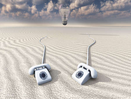 white retro phones in desert with hovering bulb photo