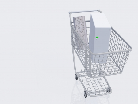 consume: Desktop computer in shopping cart Stock Photo