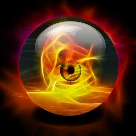 Kristallen bol met oog binnen brand Stockfoto