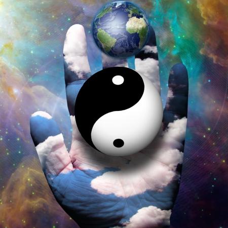 yin yang: Yin Yang y la Tierra flotar por encima de la mano