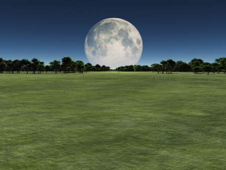 Moon over green landscape Stock Photo
